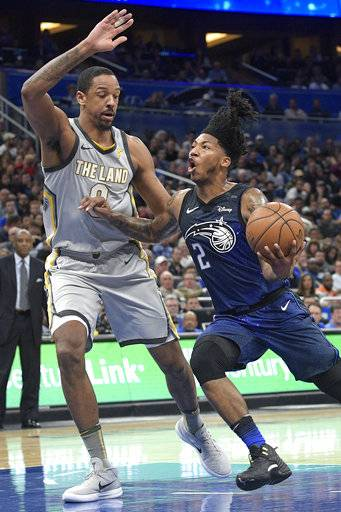 Orlando Magic guard Elfrid Payton (2) drives to the basket in front of Cleveland Cavaliers forward Channing Frye during the second half of an NBA basketball game Tuesday, Feb. 6, 2018, in Orlando, Fla. The Magic won 116-98.