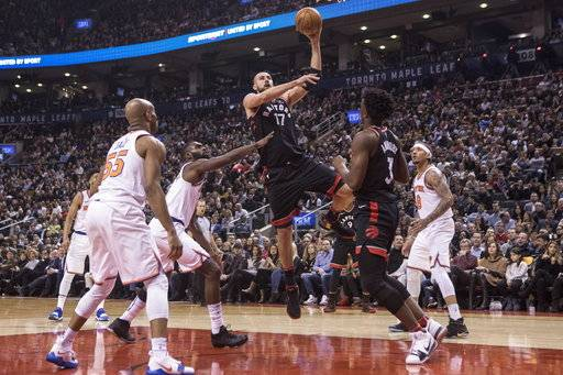 Toronto Raptors Jonas Valanciunas shoots against the New York Knicks during the first half of an NBA basketball game Thursday, Feb. 8, 2018, in Toronto. (Chris Young/The Canadian Press via AP)