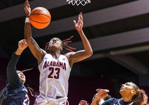 Alabama guard Shaquera Wade (23) reaches for a rebound with South Carolina forward LaDazhia Williams (23) defending against her and South Carolina forward Mikiah Herbert Harrigan, right, looking on during an NCAA college basketball game Thursday, Feb. 8, 2018, in Tuscaloosa, Ala. (Vasha Hunt/AL.com via AP)