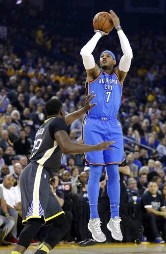 Oklahoma City Thunder's Carmelo Anthony (7) shoots over Golden State Warriors' Draymond Green during the first half of an NBA basketball game Tuesday, Feb. 6, 2018, in Oakland, Calif.