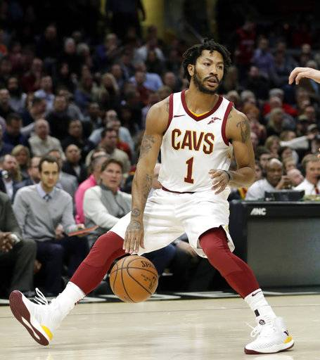 FILE - In this Jan. 31, 2018, file photo, Cleveland Cavaliers' Derrick Rose (1) drives against the Miami Heat in the first half of an NBA basketball game, in Cleveland.   The Cavaliers sent guard Derrick Rose and forward Jae Crowder to the Utah Jazz for forward Rodney Hood, Thursday, Feb. 8, 2018.