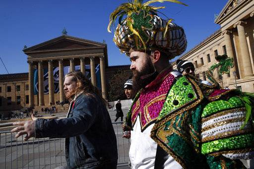 Philadelphia Eagles center Jason Kelce, right, arrives in front of the Philadelphia Museum of Art after a Super Bowl victory parade for the Philadelphia Eagles football team, Thursday, Feb. 8, 2018, in Philadelphia. The Eagles beat the New England Patriots 41-33 in Super Bowl 52.