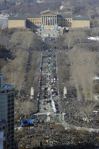 The Philadelphia Eagles parade up the Benjamin Franklin Parkway towards the Philadelphia Museum of Art, rear, during a Super Bowl victory parade, Thursday, Feb. 8, 2018, in Philadelphia. The Eagles beat the New England Patriots 41-33 in Super Bowl 52.