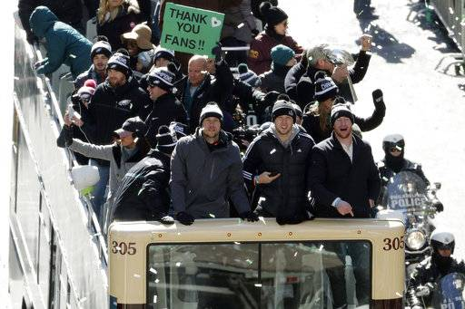 Philadelphia Eagles NFL football team quarterbacks Nick Foles, from left, Nate Sudfeld and Carson Wentz celebrate during a Super Bowl victory parade, Thursday, Feb. 8, 2018, in Philadelphia. The Eagles beat the New England Patriots 41-33 in Super Bowl 52.