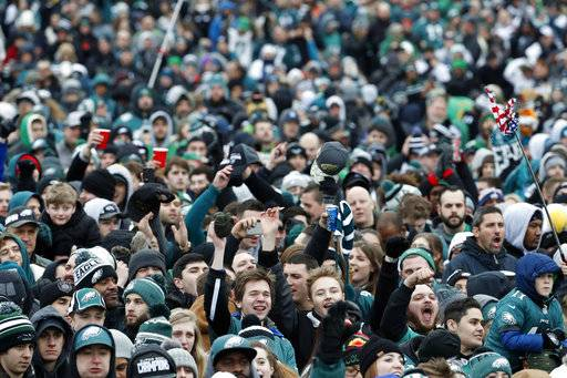 Fans cheer as they watch a replay of Super Bowl 52 in front of the the Philadelphia Museum of Art before a Super Bowl victory parade for the Philadelphia Eagles NFL football team, Thursday, Feb. 8, 2018, in Philadelphia. The Eagles beat the New England Patriots 41-33 in Super Bowl 52.