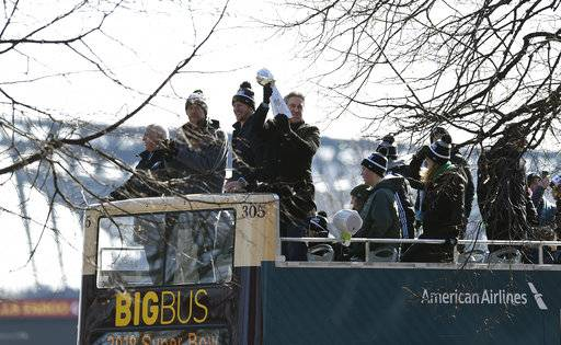 Philadelphia Eagles NFL football head coach Doug Pederson holds up the Vince Lombardi trophy during the Super Bowl LII victory parade, Thursday, Feb 8, 2018, in Philadelphia. From left are Eagles owner Jeffrey Lurie, quarterbacks Nick Foles and Carson Wentz and coach Pederson.