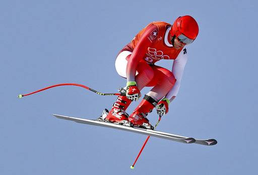 Switzerland's Mauro Caviezel makes a jump in Men's Downhill training at the 2018 Winter Olympics in Jeongseon, South Korea, Thursday, Feb. 8, 2018.