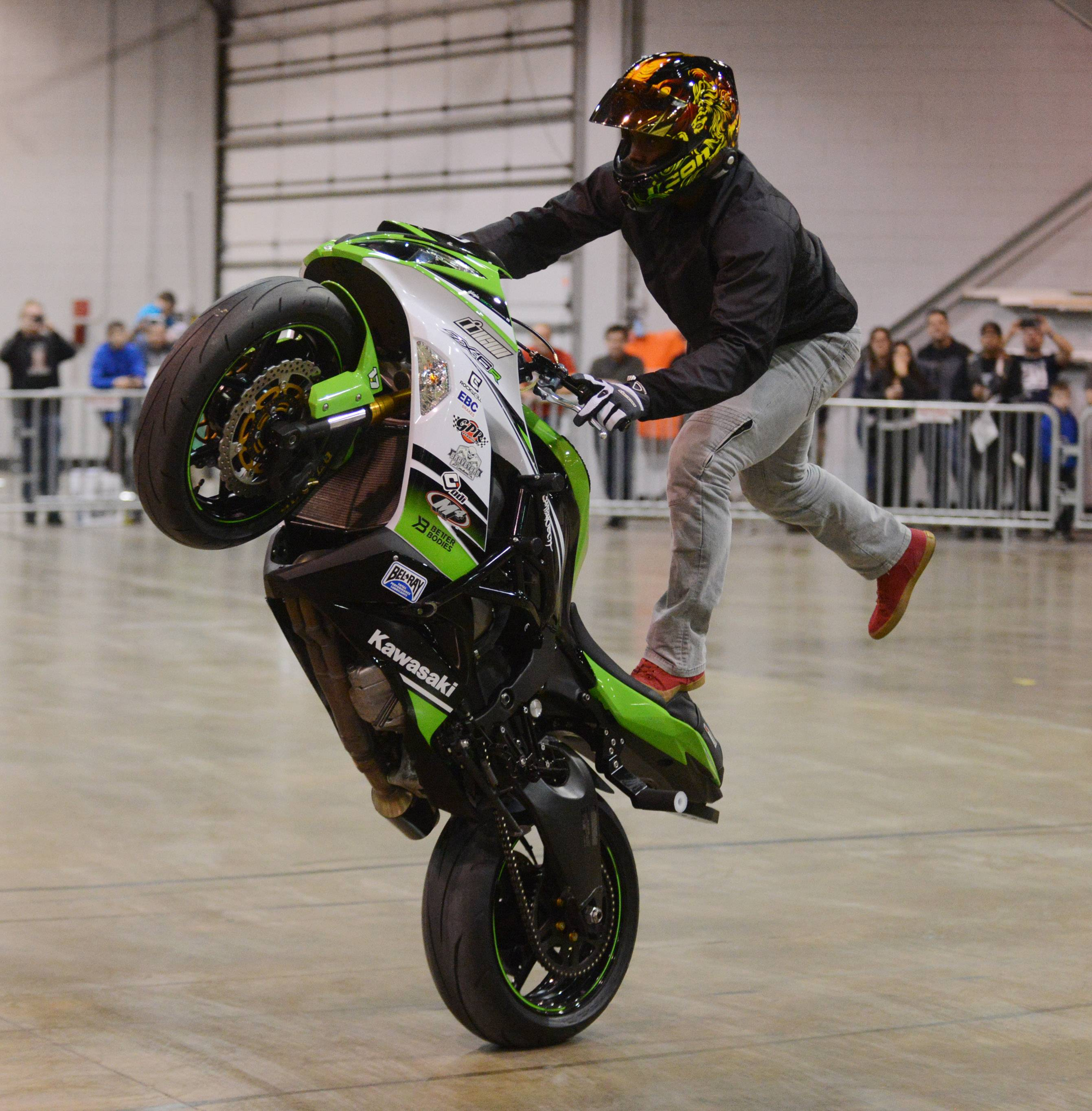 A stunt rider performs during a previous Progressive International Motorcycle Show at the Donald E. Stephens Convention Center in Rosemont.
