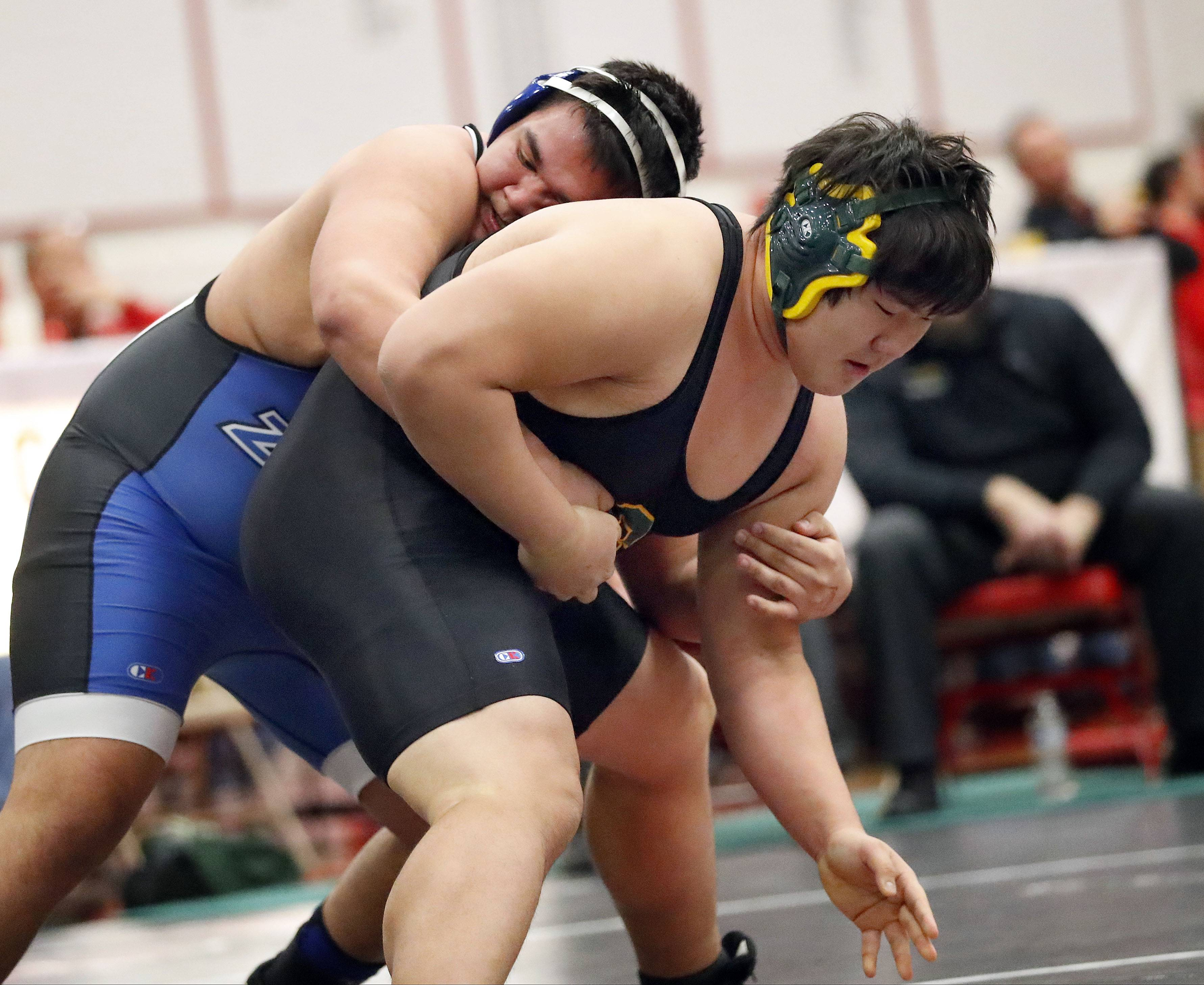 Lake Zurich's Matt Wach, left, takes on Stevenson's Anand Batbaatar at 285 pounds during Class 3A sectional wrestling action Friday night at Barrington High School.