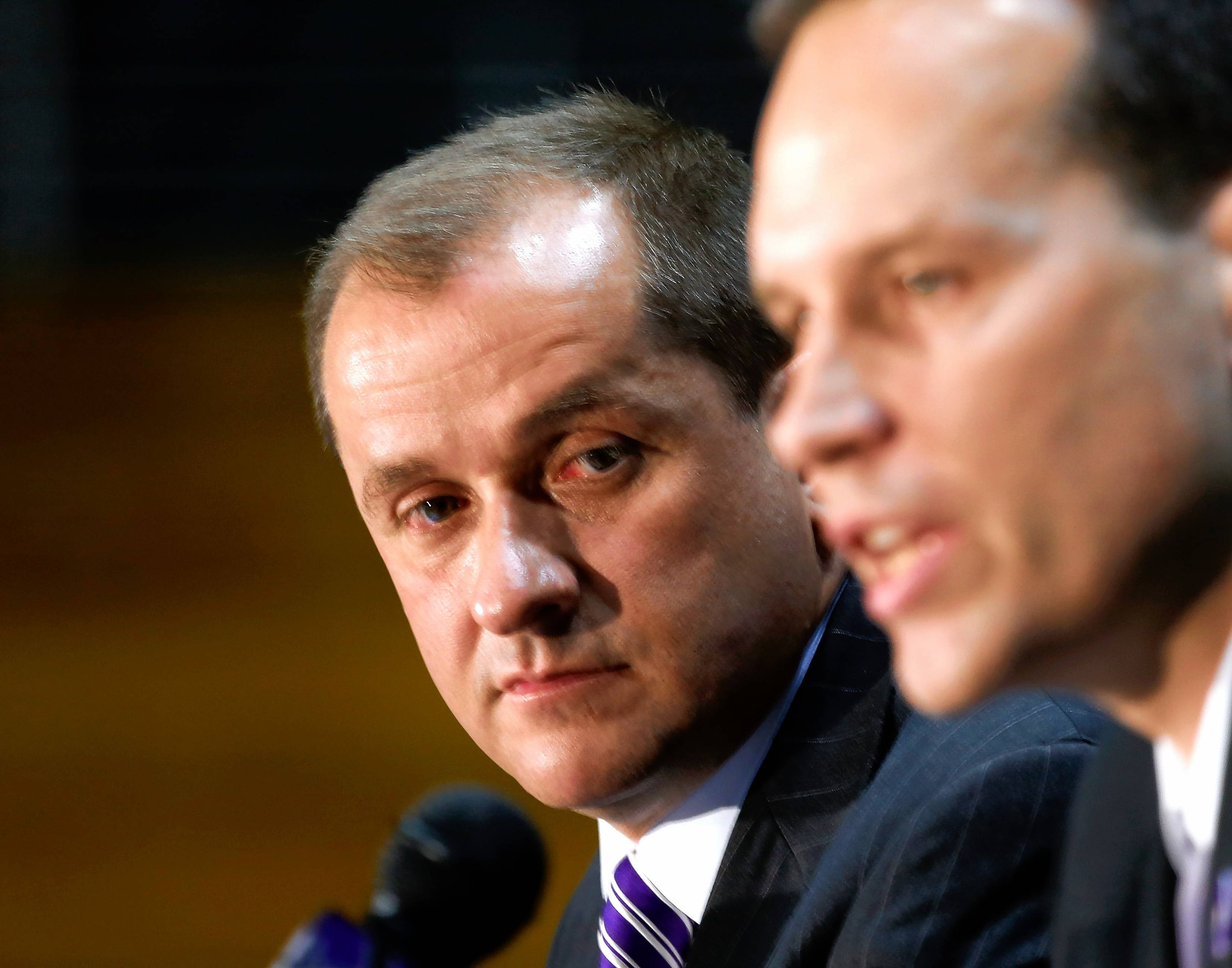 Jim Phillips, left, now the athletics director at Northwestern University, says he'll never forget the give students killed on the Northern Illinois University campus 10 years ago when he worked there. He plans to attend this week's memorial.