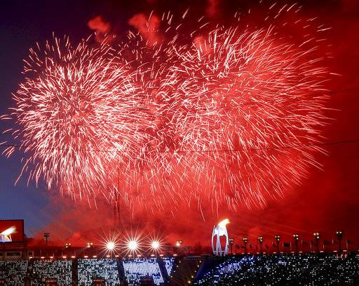 FILE - In this Friday, Feb. 9, 2018 file photo, fireworks explode after the Olympic flame was lit during the opening ceremony of the 2018 Winter Olympics in Pyeongchang, South Korea. On Friday, Feb. 9, 2018, The Associated Press has found that stories circulating on the internet that the death toll is rising rapidly from an outbreak of norovirus at the games are untrue. Norovirus is a common, infections bug that causes unpleasant symptoms but usually doesn't require medical attention. (Sean Haffey/Pool Photo via AP)