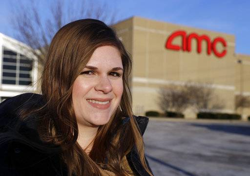 In this Tuesday, Jan. 30, 2018, photo, Cassie Langdon stands outside of AMC Indianapolis 17 theatre in Indianapolis. With MoviePass, Langdon said she's taking more chances on smaller releases instead of sticking with blockbusters and their sequels.