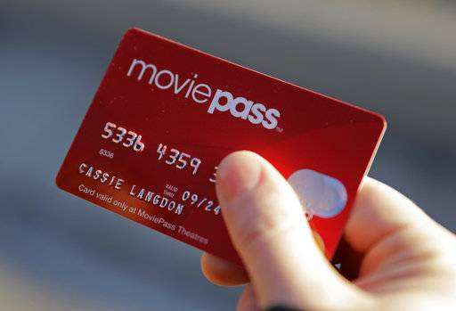 In this Tuesday, Jan. 30, 2018, photo, Cassie Langdon holds her MoviePass card outside AMC Indianapolis 17 theatre in Indianapolis. With MoviePass, Langdon said she's taking more chances on smaller releases instead of sticking with blockbusters and their sequels.