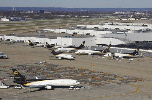 In this Nov. 20, 2015 picture, UPS airplanes sit on a tarmac at the company's Worldport hub in Louisville, Ky. Shares of delivery companies FedEx and UPS are falling in Friday, Feb. 9, 2018, premarket trading following a report that powerhouse Amazon is readying its own delivery service for businesses.