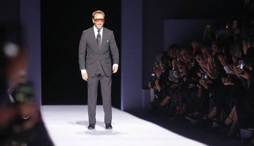 Fashion designer Tom Ford appears on the runway after showing his latest collection during Fashion Week, Thursday Feb. 8, 2018, in New York.