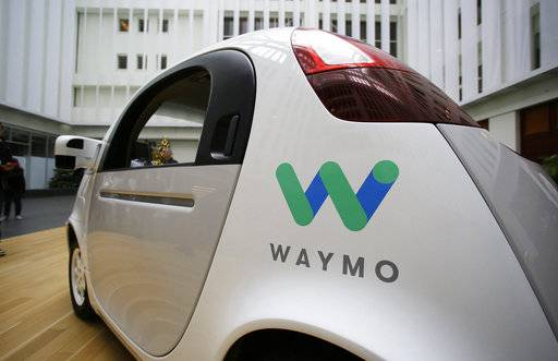 FILE - In this Dec. 13, 2016, file photo, the Waymo driverless car is displayed during a Google event in San Francisco. Uber is settling a lawsuit filed by Google's autonomous car unit alleging that the ride-hailing service ripped off self-driving car technology. Both sides in the case issued statements confirming the settlement Friday, Feb. 9, 2018, morning in the midst of a federal court trial in the case.