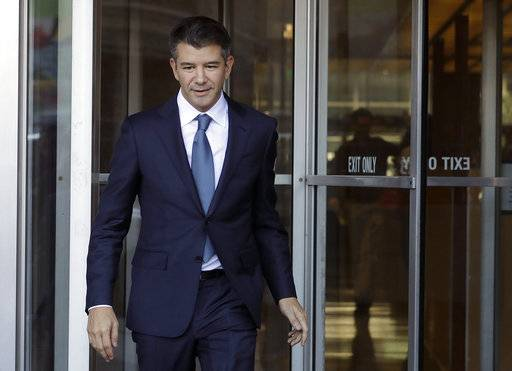 FILE- In this Feb. 7, 2018, file photo, former Uber CEO Travis Kalanick leaves federal court in San Francisco. Uber has settled a lawsuit alleging that it ripped off self-driving car technology from Google's autonomous vehicle division, both confirmed the settlement Friday, Feb. 9, 2018. In the lawsuit, Waymo contended that former Uber CEO Travis Kalanick teamed up with ex-Google engineer Anthony Levandowski to steal LIDAR laser sensor technology.