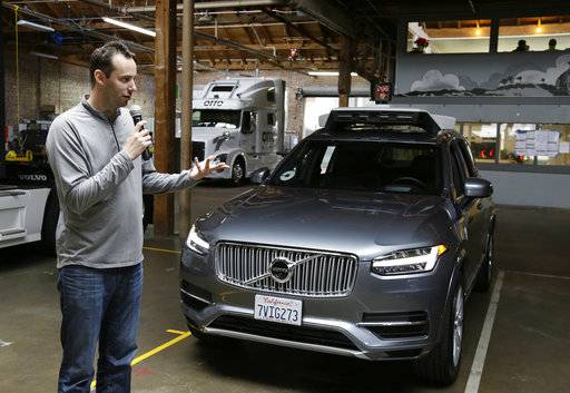 FILE- In this Dec. 13, 2016, file photo, Anthony Levandowski, head of Uber's self-driving program, speaks about their driverless car in San Francisco. Uber has settled a lawsuit alleging that it ripped off self-driving car technology from Google's autonomous vehicle division, both confirmed the settlement Friday, Feb. 9, 2018. In the lawsuit, Waymo contended that former Uber CEO Travis Kalanick teamed up with ex-Google engineer Levandowski to steal LIDAR laser sensor technology.