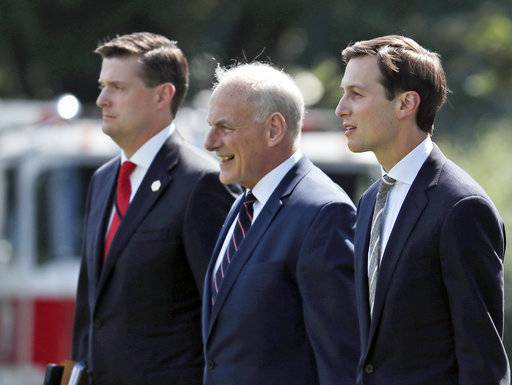 FILE - In this Aug. 4, 2017 file photo, from left, White House Staff Secretary Rob Porter, White House Chief of Staff John Kelly, and White House senior adviser Jared Kushner walk to Marine One on the South Lawn of the White House in Washington. President Donald Trump was en route to Bedminster, N.J., for vacation.  White House staff secretary Porter has resigned following allegations of domestic abuse by his two ex-wives.