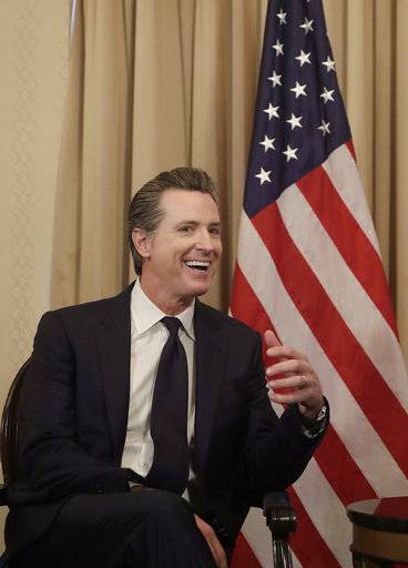 California Lt. Gov. Gavin Newsom smile while meeting with Canada's Prime Minister Justin Trudeau in San Francisco, Friday, Feb. 9, 2018.