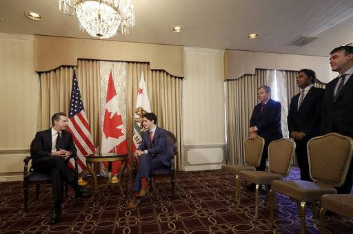 Canada's Prime Minister Justin Trudeau, center, meets with California Lt. Gov. Gavin Newsom, left, in San Francisco, Friday, Feb. 9, 2018.