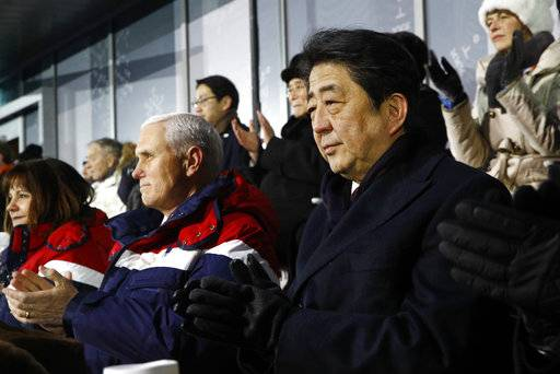 Japanese Prime Minister Shinzo Abe, right, sits alongside U.S. Vice President Mike Pence, center, and second lady Karen Pence at the opening ceremony of the 2018 Winter Olympics in Pyeongchang, South Korea, Friday, Feb. 9, 2018.