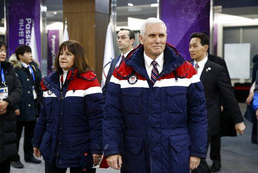 Vice President Mike Pence, right, walks to his seat alongside second lady Karen Pence at the opening ceremony of the 2018 Winter Olympics in Pyeongchang, South Korea, Friday, Feb. 9, 2018.