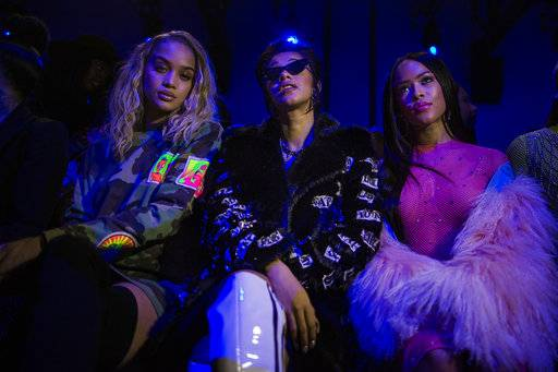 Jasmine Sanders, from left, Cardi B and Serayah McNeill attend the Jeremy Scott show during Fashion Week in New York, Thursday, Feb. 8, 2018.