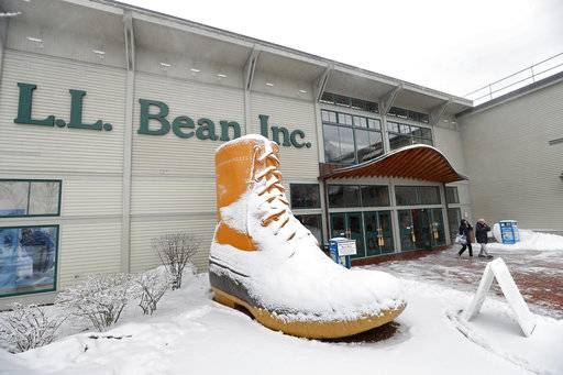 In this Friday, Feb. 2, 2018 photo customers leave the LL Bean retail store in Freeport, Maine. The outdoor retailer is imposing a one-year limit on most returns to reduce growing abuse and fraud.