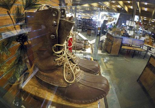 FILE - In this March 17, 2017 file photo, a early version of the Maine Hunting Shoe is displayed at the L.L. Bean flagship store in Freeport, Maine. L.L. Bean is tightening its generous return policy by imposing a one-year limit on most returns to reduce abuse and fraud. Executives say returns of severely worn items have doubled over five years. Under the new policy announced Friday, Feb. 9, 2018, the company will accept returns for one year with a proof of purchase and will continue to replace products for manufacturing defects beyond that.