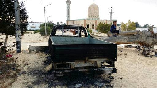 FILE - In this Nov. 25, 2017 file photo, a burned truck is seen outside Al-Rawda Mosque in Bir al-Abd northern Sinai, Egypt a day after attackers killed hundreds of worshippers. Egypt's military says it has begun a major security operation in areas including the restive northern Sinai Peninsula, where Islamic militants are most active.