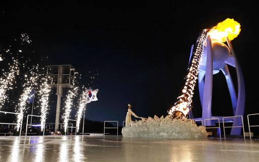 South Korean Olympic figure skating champion Yuna Kim lights the Olympic flame during the opening ceremony of the 2018 Winter Olympics in Pyeongchang, South Korea, Friday, Feb. 9, 2018.