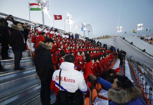 Members of the North Korean delegation sit before the opening ceremony of the 2018 Winter Olympics in Pyeongchang, South Korea, Friday, Feb. 9, 2018.