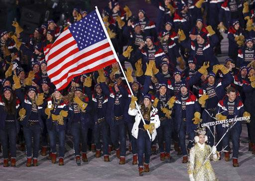 Erin Hamlin carries the flag of the United States during the opening ceremony of the 2018 Winter Olympics in Pyeongchang, South Korea, Friday, Feb. 9, 2018.