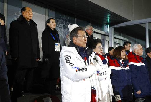 South Korean President Moon Jae-in, center, stands alongside first lady Kim Jung-sook, U.S. second lady Karen Pence and U.S. Vice President Mike Pence as the South Korean national anthem is played at the opening ceremony of the 2018 Winter Olympics in Pyeongchang, South Korea, Friday, Feb. 9, 2018. Standing at top left is Kim Yong Nam, president of the Presidium of North Korean Parliament, and Kim Yo Jong, sister of North Korean leader Kim Jong Un.
