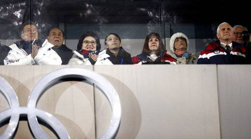 Kim Yong Nam, president of the Presidium of the North's Parliament, second from left in the back, and Kim Jong Un's sister Kim Yo Jong, center, observe with South Korean President Moon Jae-in, front left, first lady Kim Jung-sook,  second lady Karen Pence, and United States Vice President Mike Pence during the opening ceremony of the 2018 Winter Olympics in Pyeongchang, South Korea, Friday, Feb. 9, 2018.