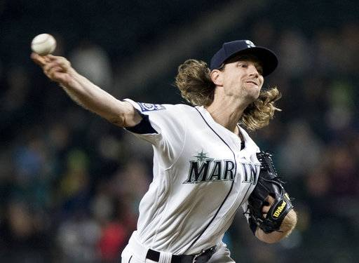 FILE - In this Sept. 19, 2017, file photo, Seattle Mariners starting pitcher Mike Leake throws against the Texas Rangers in the sixth inning of a baseball game, in Seattle. The backend of Seattle's starting rotation is the biggest question entering spring training. The Mariners are set at the top with James Paxton and Mike Leake.