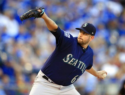 FILE - In this Aug. 4, 2017, file photo, Seattle Mariners starting pitcher James Paxton delivers to a Kansas City Royals batter during the first inning of a baseball game at Kauffman Stadium in Kansas City, Mo. The backend of Seattle's starting rotation is the biggest question entering spring training. The Mariners are set at the top with James Paxton and Mike Leake.