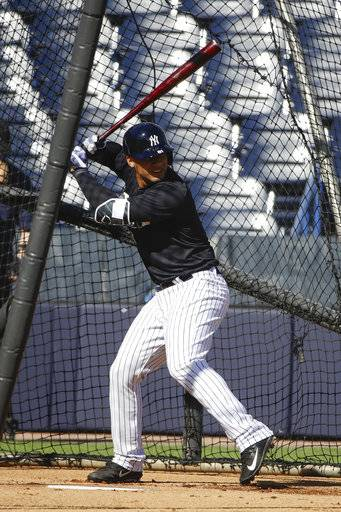 FILE - In this Feb. 17, 2017, file photo, New York Yankees' Gleyber Torres takes swings during a spring training baseball workout in Tampa, Fla. Torres, voted top player in the 2016 Arizona Fall League, will be given a chance to take over from Starlin Castro at second base for the Yankees.