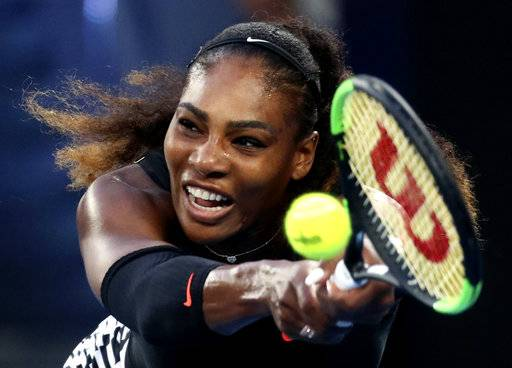 FILE - In this Jan. 28, 2017, file photo, Serena Williams makes a backhand return to her sister Venus during the women's singles final at the Australian Open tennis championships in Melbourne, Australia. Five months after becoming a mother, Serena Williams is ready to return to competitive tennis for the first time since her 2017 Australian Open title. Williams will join her sister Venus in helping the United States begin its Fed Cup title defense Saturday, Feb. 10, 2018, against the Netherlands.