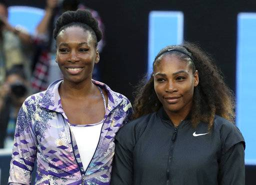 FILE - In this Jan. 28, 2017, file photo, Venus, left, and Serena Williams pose ahead of the women's singles final at the Australian Open tennis championships in Melbourne, Australia. Five months after becoming a mother, Serena Williams is ready to return to competitive tennis for the first time since her 2017 Australian Open title. Williams will join her sister Venus in helping the United States begin its Fed Cup title defense Saturday, Feb. 10, 2018, against the Netherlands.