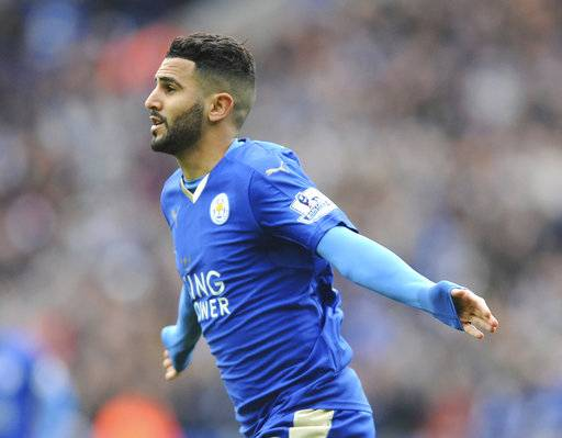 FILE - In this file photo dated Sunday, April 24, 2016, Leicesters Riyad Mahrez celebrates after scoring during he English Premier League soccer match against Swansea City at the King Power Stadium in Leicester, England.  Denied a chance for leave for new chances of glory at Manchester City, but Mahrez seems to be in a huff and won't be on the pitch at all upcoming Saturday.