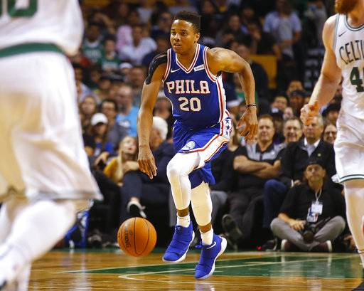 FILE - In this Oct. 9, 2017, file photo, Philadelphia 76ers guard Markelle Fultz dribbles during the first quarter of a preseason NBA basketball game against the Boston Celtics in Boston. Fultz, the top overall pick in last year's NBA draft, may not play again this season as he deals with a right shoulder injury. Fultz played the 76ers' first four games of the season but has been sidelined since. Sixers president of basketball operations Bryan Colangelo said Friday, Feb. 9, 2018, before the team plays the New Orleans Pelicans that Fultz is progressing in his recovery but with uncertainty.