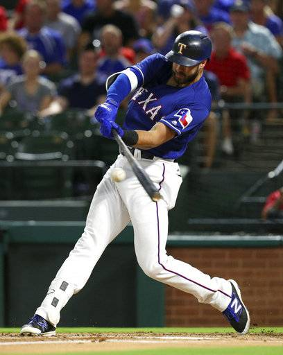 FILE - in this Sept. 25, 2017, file photo, Texas Rangers' Joey Gallo connects for a solo home run in the second inning of a baseball game against the Houston Astros in Arlington, Texas. Gallo, who hit 41 homers playing three different positions last season, could get the chance to be the team's primary first baseman.