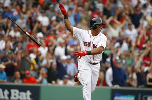 FILE - In this Oct. 8, 2017, file photo, Boston Red Sox's Rafael Devers tosses his bat after hitting a two-run home run against the Houston Astros during the third inning in Game 3 of baseball's American League Division Series, in Boston. Third baseman Devers hit .284 with 10 homers and 30 RBIs in 58 games as a 20-year-old; a full season from him is the best hope for a power boost.