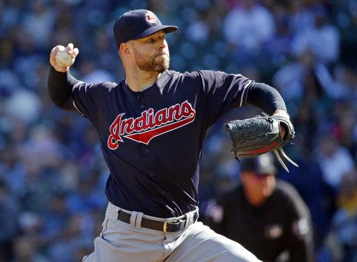FILE - In this Sept. 24, 2017, file photo, Cleveland Indians starting pitcher Corey Kluber throws against the Seattle Mariners during the first inning of a baseball game in Seattle. Determined to end their World Series title drought in 2017 after coming so close the previous season, the AL Central champions were bounced in the playoffs by the New York Yankees despite taking a 2-0 series lead. It was a bitter finish for a team that won 102 games and reeled off 22 straight victories. But while there was a sense of finality for some Cleveland fans, manager Terry Francona said these Indians aren't done.