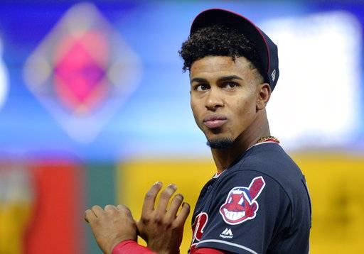 FILE - In this Oct. 11, 2017, file photo, Cleveland Indians' Francisco Lindor warms up before an American League Division Series playoff game against the New York Yankees in Cleveland. Determined to end their World Series title drought in 2017 after coming so close the previous season, the AL Central champions were bounced in the playoffs by the New York Yankees despite taking a 2-0 series lead. It was a bitter finish for a team that won 102 games and reeled off 22 straight victories. But while there was a sense of finality for some Cleveland fans, manager Terry Francona said these Indians aren't done.