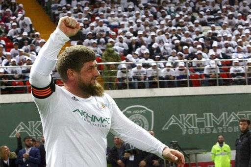 FILE - This is a Saturday, Oct. 7, 2017 file photo of Chechnya's regional leader Ramzan Kadyrov celebrates scoring against the Italian former players soccer team in Grozny, Russia. Egypt will be based at the World Cup in Chechnya with FIFA approving the facility despite the Russian region's leadership being criticized for widespread human rights violations and a crackdown on dissent. Egypt has selected a training facility in the Chechen capital Grozny for its first World Cup trip in 28 years.