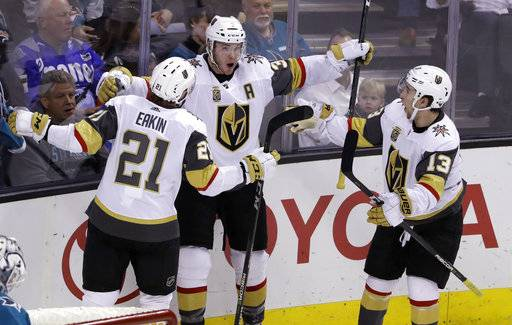 Vegas Golden Knights' Brayden McNabb, center, celebrates his goal with teammates Cody Eakin, left, and Brendan Leipsic during the third period of an NHL hockey game against the San Jose Sharks on Thursday, Feb. 8, 2018, in San Jose, Calif.
