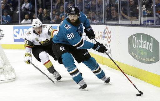 San Jose Sharks' Brent Burns, right, skates past Vegas Golden Knights' Nate Schmidt during the second period of an NHL hockey game Thursday, Feb. 8, 2018, in San Jose, Calif.